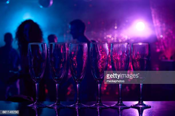 Champagne flutes on bar counter