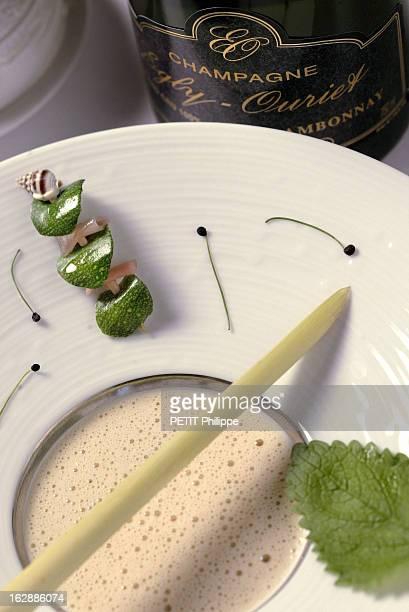 Champagne For New Year'S Eve Bouteille de champagne EglyOuriet sans année s'accordant avec le bulot nage thaï avec épices d'ail et lait de coco...