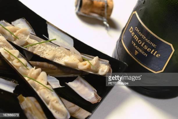 Champagne For New Year'S Eve Bouteille de champagne Vranken Demoiselle s'accordant avec des couteaux de mer Accords selon Alain SENDERENS sur des...