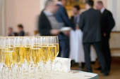 Champagne glasses against the background of business people.