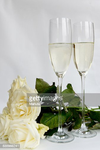 Champagne Glasses and Bunch of White Roses : Stock Photo