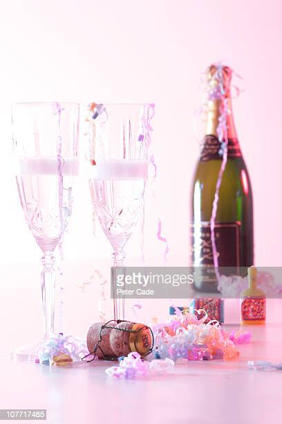 Champagne, glasses and party poppers