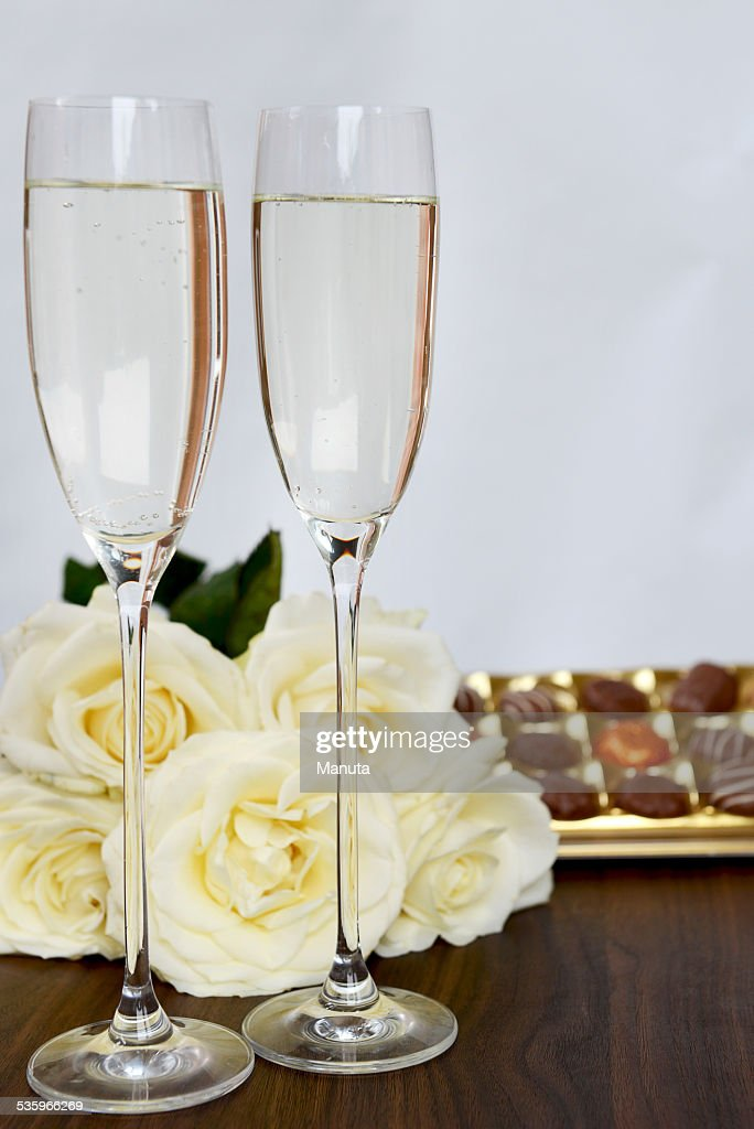 Champagne Glasses, Box of Chocolate and Bunch of White Roses : Stock Photo