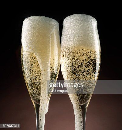 Champagne glasses overflow