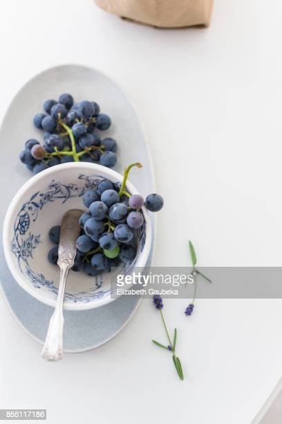 Champagne Grapes on white background with some lavender flowers