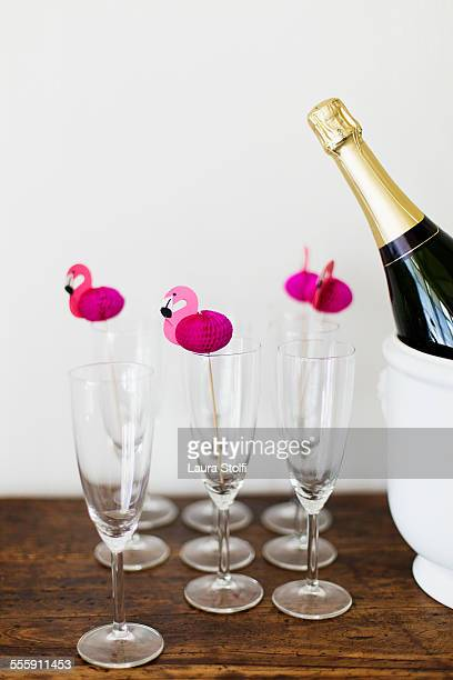 Champagne in flute glasses & pink paper flamingos