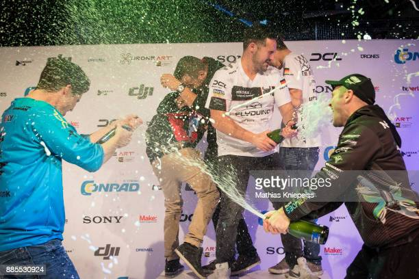 Champagne shower is seen at Station Berlin during the DCL Drone Champions League Championship Finals in Berlin on December 02 2017 in Berlin Germany