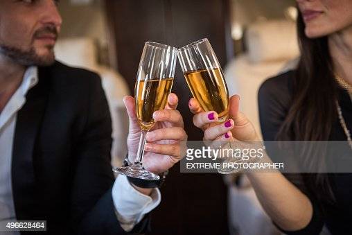 Champagne toast in private aeroplane
