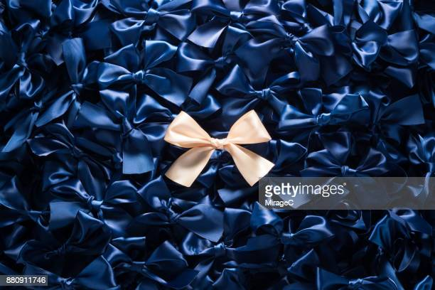 Champaign Gold Colored Ribbon Bow on Dark Blue