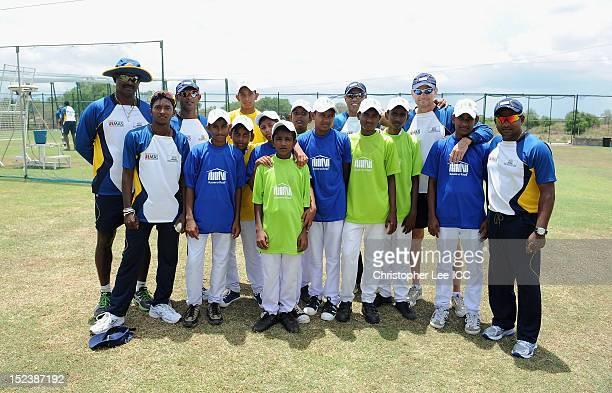 Champaka Ramanayake Akila Dhananjaya Ruwan Kalpage Charith Senanayake Graham Ford and Rangana Herath of Sri Lanka pose for a picture with children...