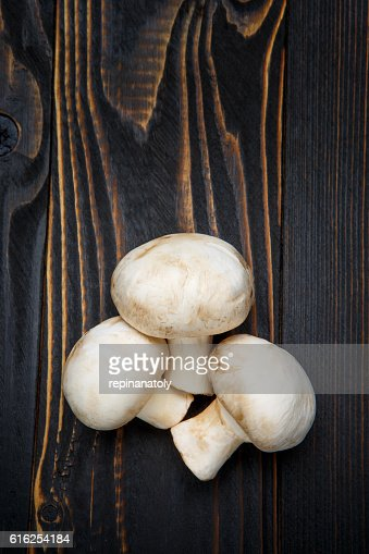 champignon mushroom on wooden background : Stock Photo