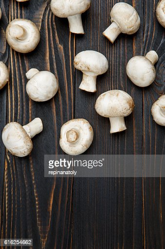 champignon mushroom on wooden background : Foto de stock