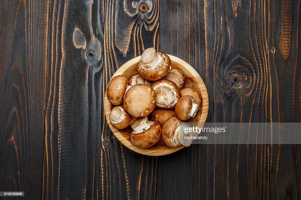 champignon mushroom on wooden background : Stock Photo
