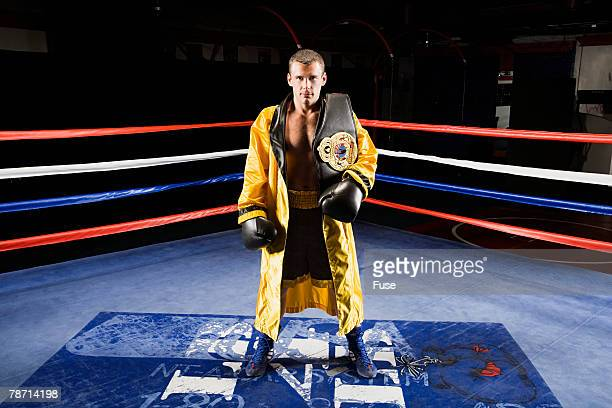 Champion Boxer Standing in Ring