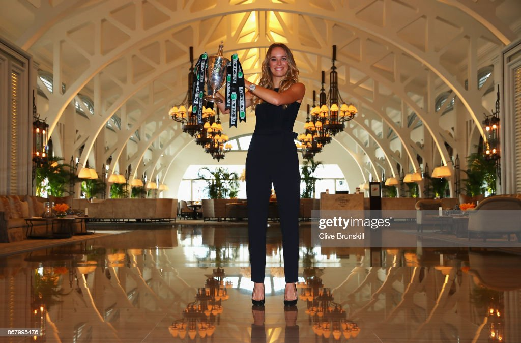Champion Caroline Wozniacki of Denmark poses with the Billie Jean King trophy after her victory against Venus Williams of the United States in the final of the BNP Paribas WTA Finals Singapore presented by SC Global at Clifford Pier on October 30, 2017 in Singapore.