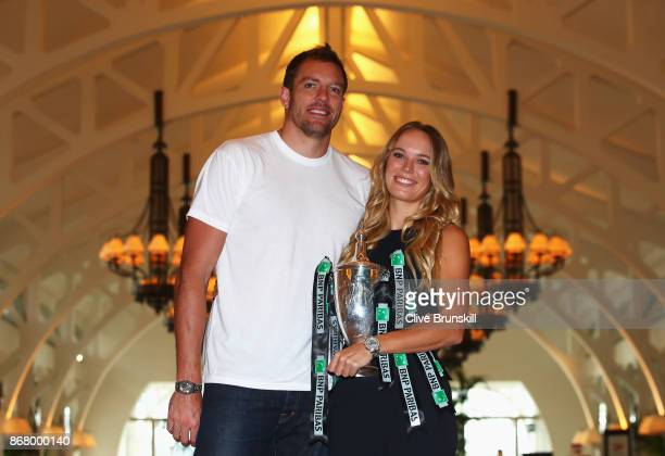 Champion Caroline Wozniacki of Denmark poses with the Billie Jean King trophy and American professional basketball player David Lee after her victory...