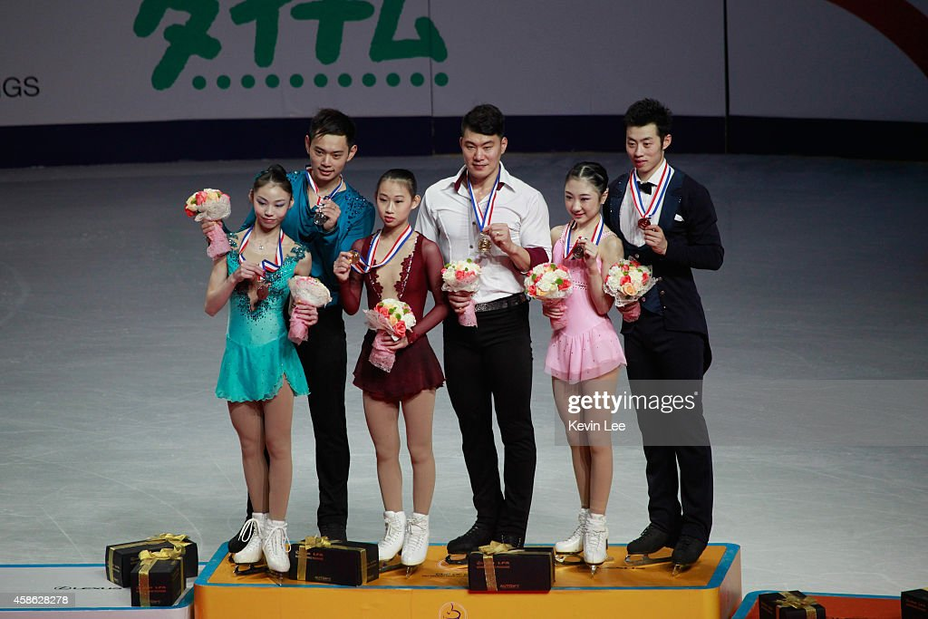 Champion Cheng Peng and Hao Zhang of China, 1st runner-up Xiaoyu Yu and Yang Jing, 2rd runner-up Xuehan Wang and Lei Wang poses for a picture on podium of Pairs Free Skating at Lexus Cup of China 2014 on November 8, 2014 in Shanghai, China.