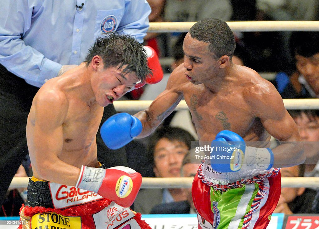 Champion Daiki Kameda (L) of Japan exchanges punches with Liborio Solis of Venezuela during their IBF Super Flyweight /WBA World Super Flyweight double titles match at the Bodymaker Colosseum on December 3, 2013 in Osaka, Japan.