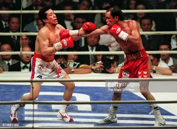 Champion Daniel Zaragoza of Mexico hits his right on challenger Joichiro Tatsuyoshi of Japan in the seventh round during their WBA Bantamweight title...