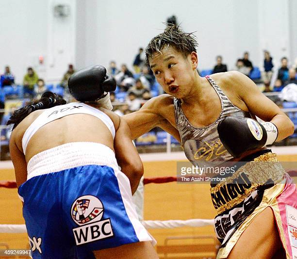 Champion Go Shindo of Japan hits her right onto challenger Judith Rodriguez of Mexico during the WBC Women's Flyweight title bout at Wakayama Big...