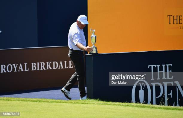 Champion Golfer of the Year Mark O'Meara of the United States touches the Claret Jug during a practice round prior to the 146th Open Championship at...