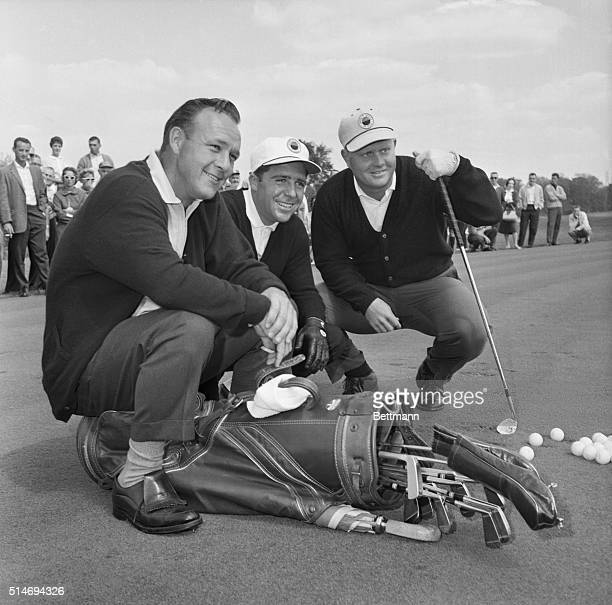 Champion golfers Arnold Palmer Gary Player and Jack Nicklaus pose with their golf clubs before a practice round at the Firestone Country Club in...