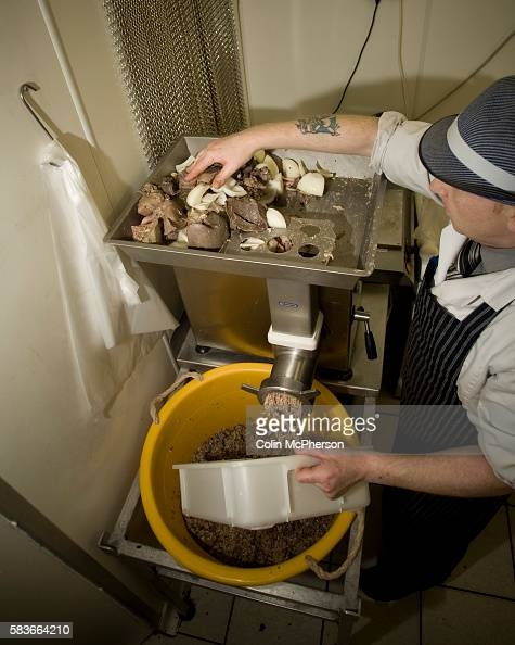 Champion haggis maker John Potter who relocated from his native Scotland to Merseyside mincing the boiled meat for haggis at Braveheart Butchers...