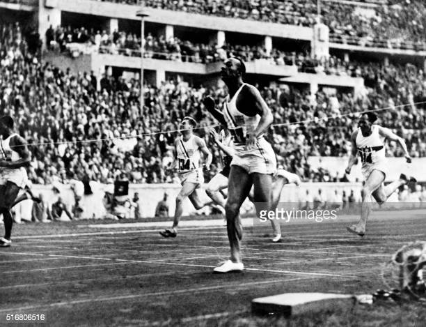 US champion 'Jesse' Owens crosses the finish line of the 100m event that he won on August 05 1936 during Olympic Games in Berlin Grandson of a slave...
