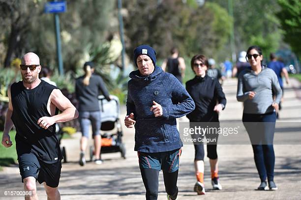 Champion jockey Hugh Bowman is seen running around The Tan track with personal trainer Trent Langlands on October 19 2016 in Melbourne Australia Hugh...