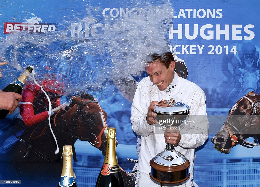 Champion jockey Richard Hughes is sprayed with water and champagne after recieving his trophy Doncaster Racecourse on November 8, 2014 in Doncaster, England.