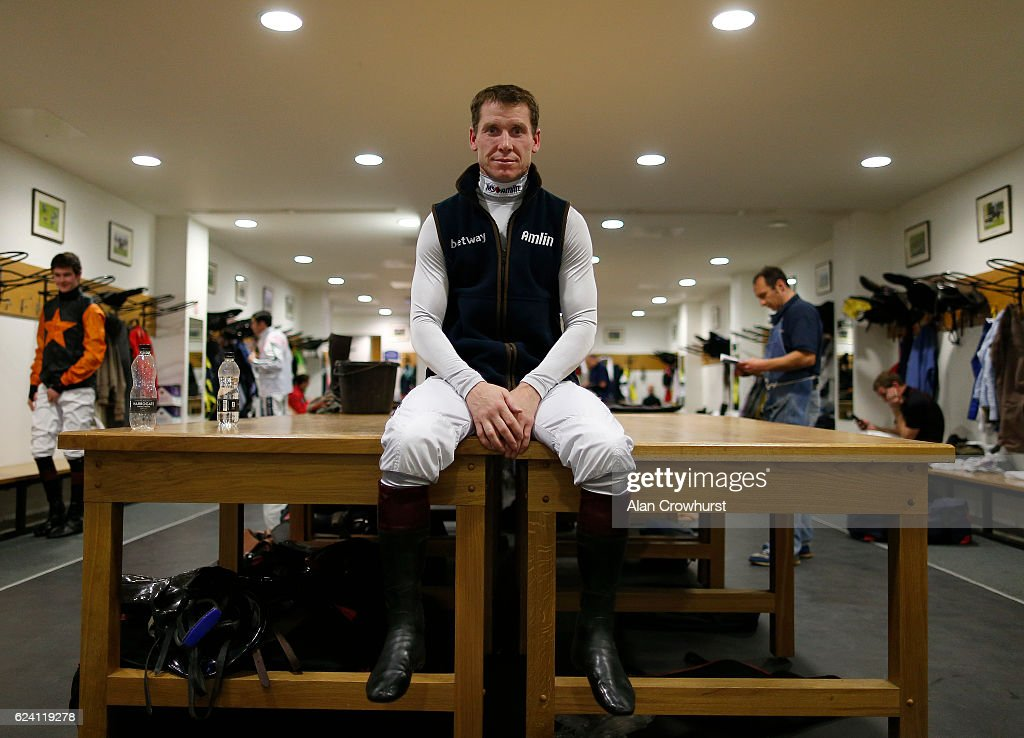 Champion jockey Richard Johnson poses in the changing room at Ascot Racecourse on November 18, 2016 in Ascot, England.