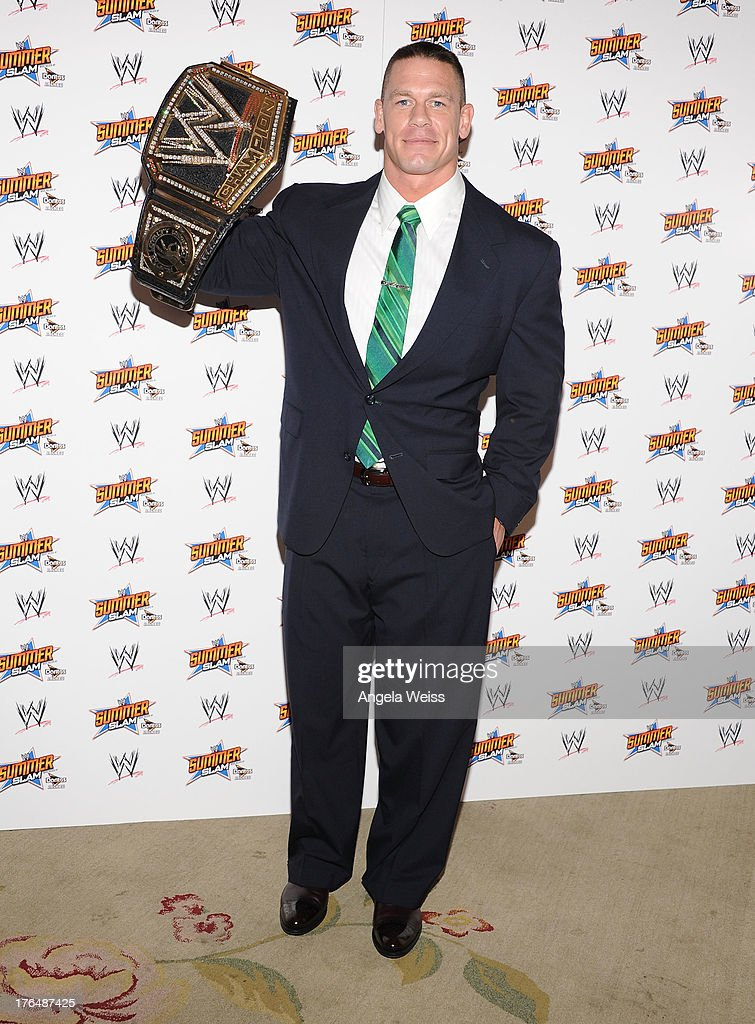 Champion <a gi-track='captionPersonalityLinkClicked' href=/galleries/search?phrase=John+Cena&family=editorial&specificpeople=644116 ng-click='$event.stopPropagation()'>John Cena</a> attends the WWE SummerSlam press conference at Beverly Hills Hotel on August 13, 2013 in Beverly Hills, California.