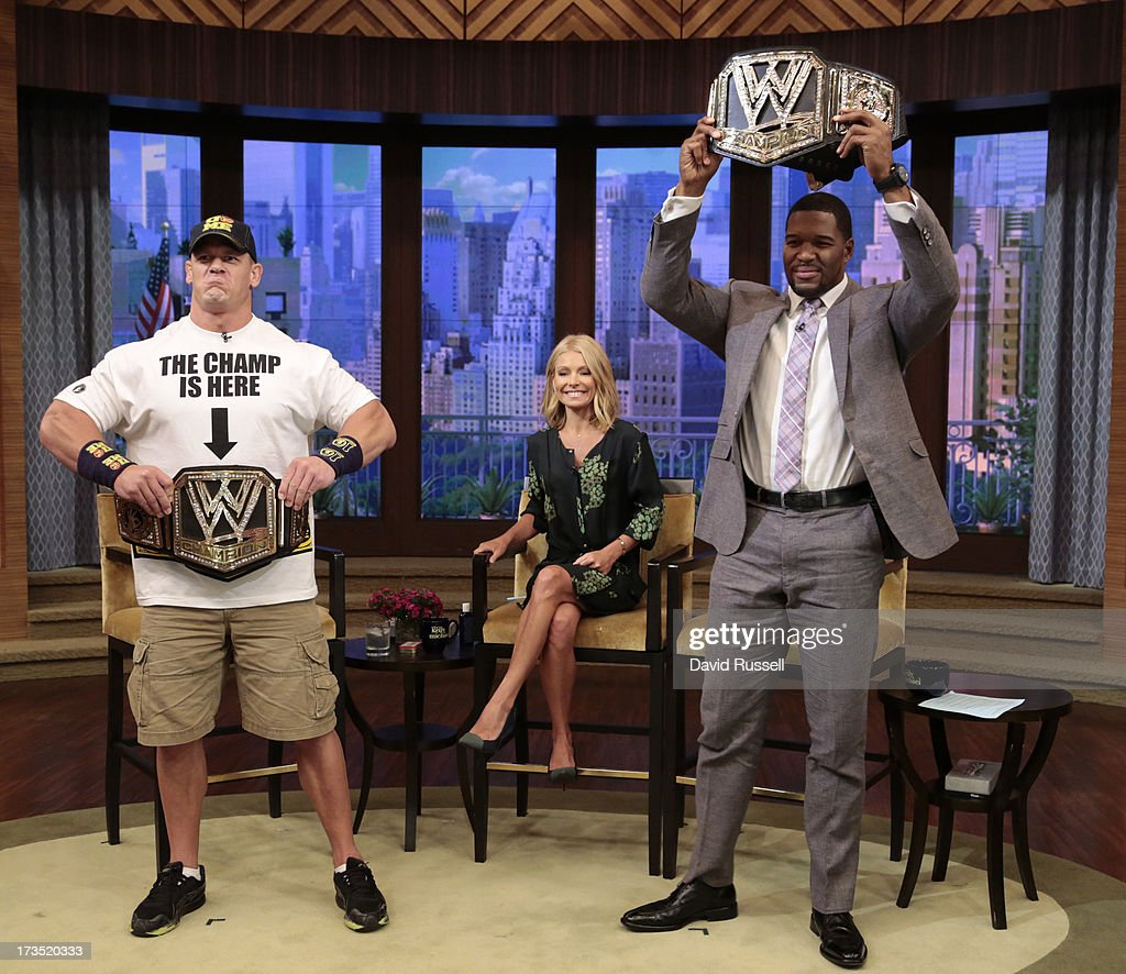 Champion JOHN CENA returned to LIVE with Kelly and Michael today, MONDAY, JULY 15, 2013. After co-host Michael Strahan and Cena exchanged some trash talk during the WWE Superstars last appearance on LIVE, today the two duked it out in a no-holds-barred wrestling showdown, Sumo-style on 'LIVE with Kelly and Michael,' distributed by Disney-ABC Domestic Television. JOHN