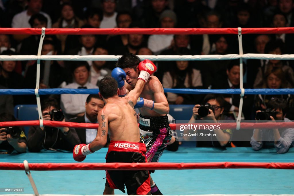 Champion Juan Carlos Reveco (L) of Argentina connects his left on challenger Masayuki Kuroda in the 8th round during the WBA Flyweight title bout between Juan Carlos Reveco and Masayuki Kuroda at Todoroki Arena on February 27, 2013 in Kawasaki, Kanagawa, Japan.