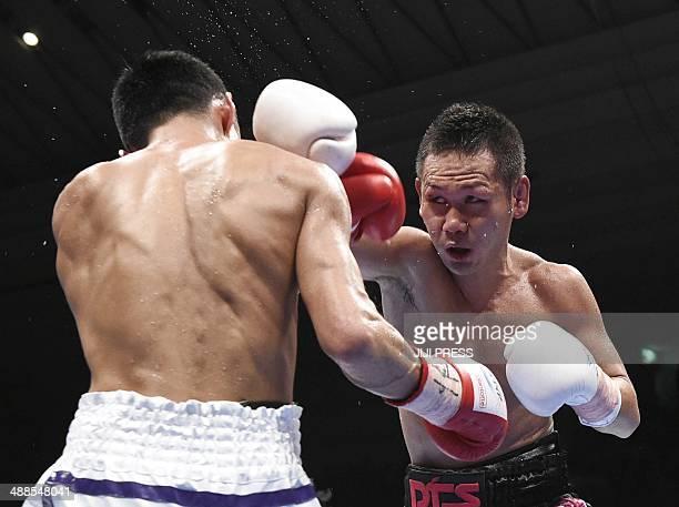 Champion Katsunari Takayama of Japan lands his right straight on his compatriot Shin Ono at the IBF minimumweight title match in Osaka on May 7 2014...