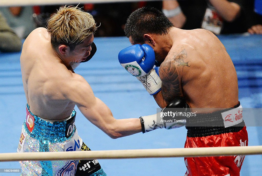 Champion Kazuto Ioka of Japan and (R) Wisanu Kokietgym of Thailand exchange punches during their WBA Light Flyweight title bout at Bodymaker Colosseum on May 8, 2013 in Osaka, Japan.