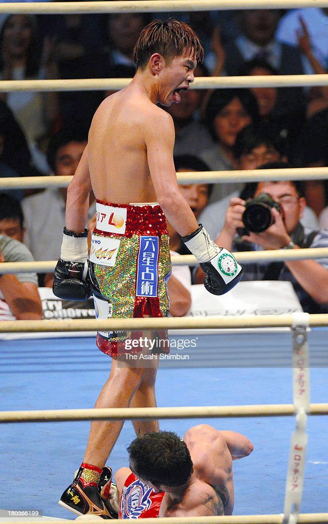 Champion Kazuto Ioka of Japan knocks out challenger Kwanthai Sithmorseng of Thailand in the seventh round during their WBA Light Flyweight championship at Body Maker Colosseum on September 11, 2013 in Osaka, Japan.