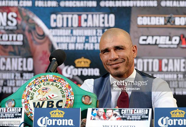 WBC champion Miguel Cotto poses with his belt during a news conference with contender Canelo Alvarez Former WBC and WBA Super Welterweight World...