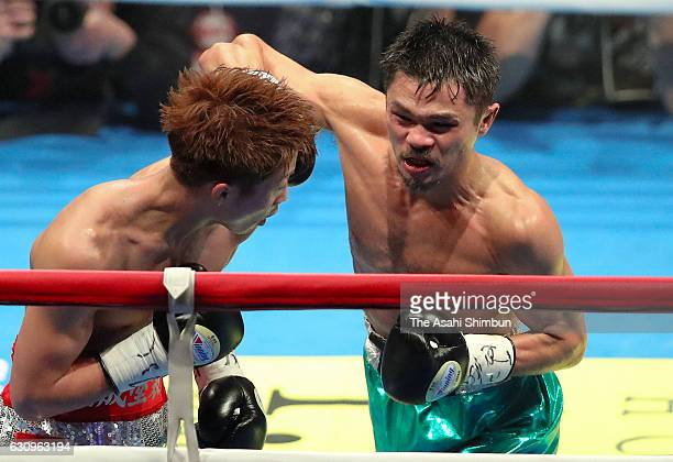 Champion Naoya Inoue of Japan and challenger Kohei Kono of Japan exchange punches during the WBO Super Flyweight title bout at Ariake Coliseum on...