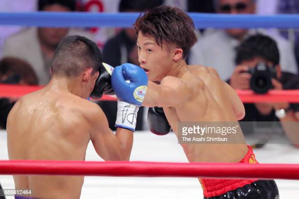 Champion Naoya Inoue of Japan connects his left on challenger Ricardo Rodriguez of Mexico in the second round during the WBO Super Flyweight title...