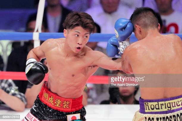 Champion Naoya Inoue of Japan connects his left on challenger Ricardo Rodriguez of Mexico in the third round during the WBO Super Flyweight title...