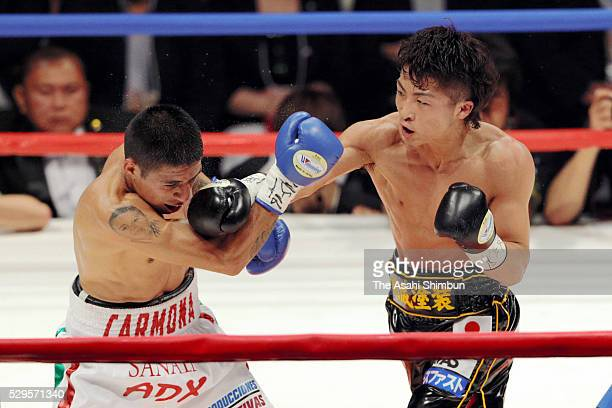 Champion Naoya Inoue of Japan connects his right on challenger David Carmona of Mexico during their WBO Super Flyweight Title Bout at the Ariake...