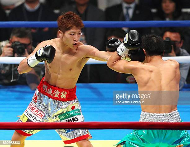 Champion Naoya Inoue of Japan connects left on challenger Kohei Kono of Japan in the 1st round during the WBO Super Flyweight title bout at Ariake...