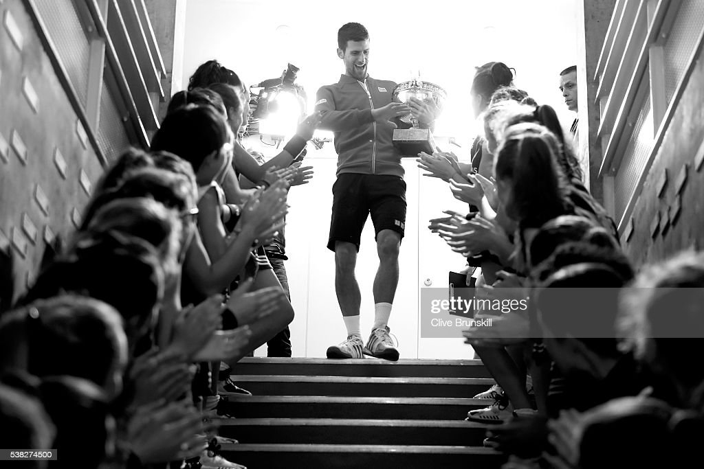 Champion Novak Djokovic of Serbia celebrates with the ball girls following his victory during the Men's Singles final match against Andy Murray of Great Britain on day fifteen of the 2016 French Open at Roland Garros on June 5, 2016 in Paris, France.