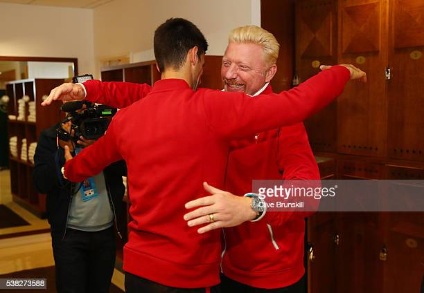Champion Novak Djokovic of Serbia clebrates with his coach Boris Becker following his victory during the Men's Singles final match against Andy...