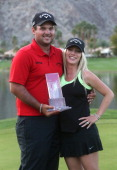 Champion Patrick Reed and wife Justine pose with the trophy after the final round of the Humana Challenge in partnership with the Clinton Foundation...