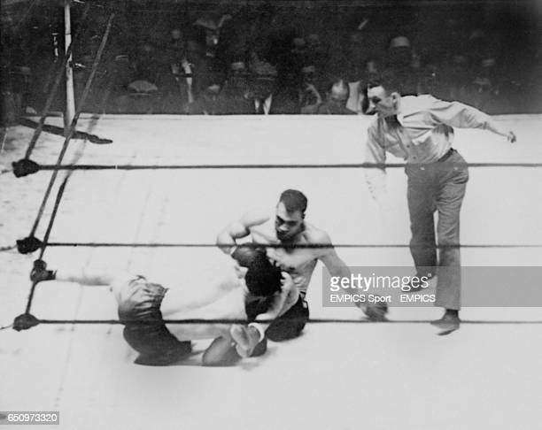Champion Primo Carnera lays into challenger Max Baer as the two boxers try to regain their feet Baer having lost his balance after knocking Carnera...