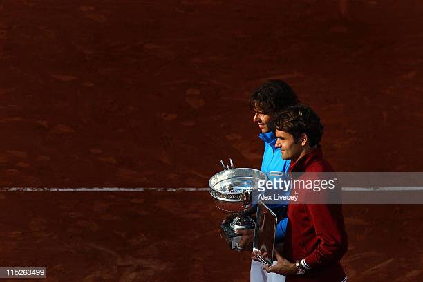 Champion Rafael Nadal of Spain and runner up Roger Federer of Switzerland pose following the men's singles final match between Rafael Nadal of Spain...
