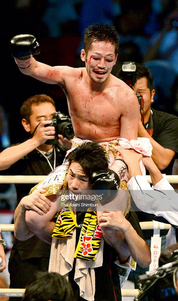 Champion Ryo Miyazaki of Japan celebrates winning against challenger Jesus Silvestre (not pictured) of Mexico after their WBA Minimumweight Championship at Body Maker Colosseum on September 11, 2013 in Osaka, Japan.