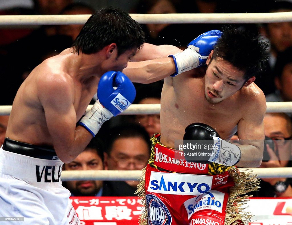 Champion Ryo Miyazaki of Japan throws his right to Carlos Velarde of Mexico at fourth round during their WBA Light Minimumweight title bout at Bodymaker Colosseum on May 8, 2013 in Osaka, Japan.